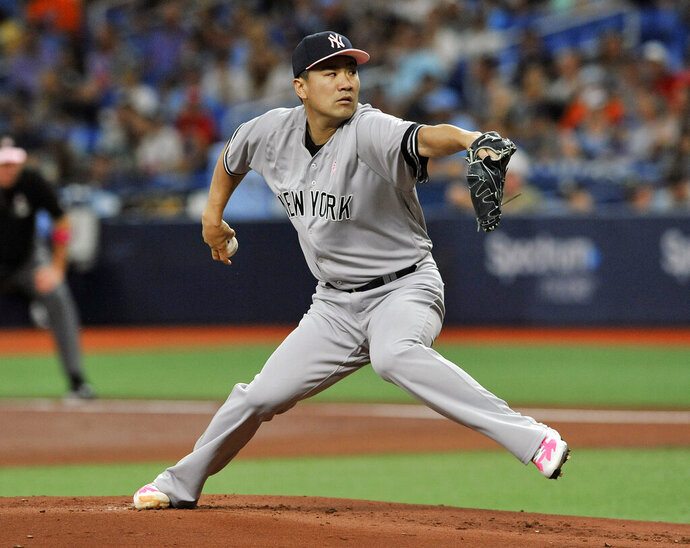New York Yankees starter Masahiro Tanaka pitches against the Tampa Bay Rays during the first inning of a baseball game Sunday, May 12, 2019, in St. Petersburg, Fla. (AP Photo/Steve Nesius)