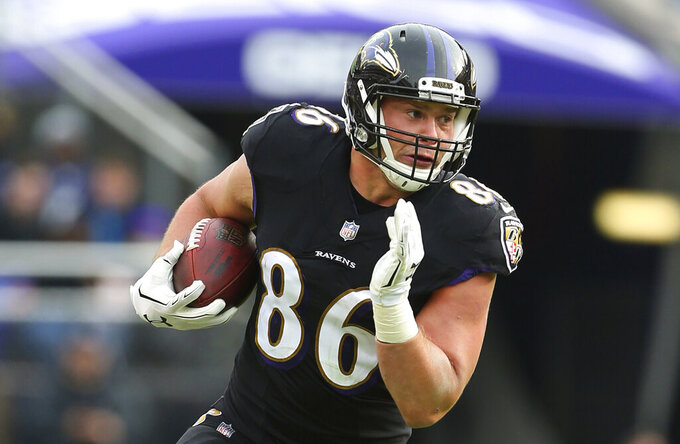 FILE - In this Nov. 18, 2018, file photo, Baltimore Ravens tight end Nick Boyle runs against the Cincinnati Bengals during an NFL football game, in Baltimore. The Ravens have signed Nick Boyle to a three-year contract, the latest in a series of moves by first-year general manager Eric DeCosta during a busy offseason. Though Boyle has not scored a touchdown over his four NFL seasons, the 6-foot-4, 270-pounder has value that transcends catches and scores. (AP Photo/Rich Schultz, File)