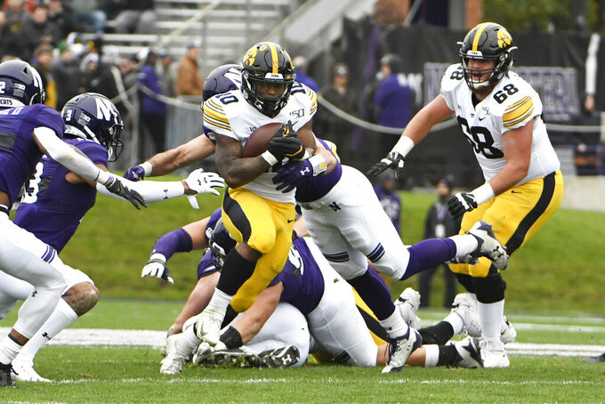 Iowa running back Mekhi Sargent (10) runs against Northwestern during the first half of an NCAA college football game, Saturday, Oct. 26, 2019, in Evanston, Ill. (AP Photo/David Banks)