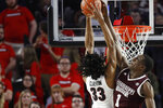Georgia forward Nicolas Claxton (33) is denied at the basket by Mississippi State forward Reggie Perry (1) during an NCAA college basketball game in Athens, Ga., Wednesday, Feb. 20, 2019. (Joshua L. Jones/Athens Banner-Herald via AP)