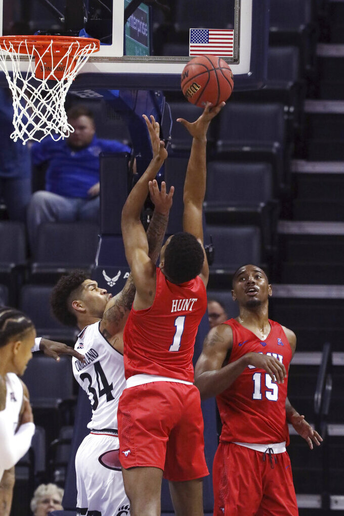 SMU's Feron Hunt takes a rebound back to the basket as Cincinnati's Jarron Cumberland defends during the second half of an NCAA college basketball game at the American Athletic Conference men's tournament Friday, March 15, 2019, in Memphis, Tenn. (AP Photo/Troy Glasgow)