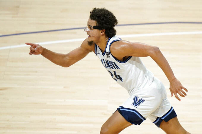 Villanova's Jeremiah Robinson-Earl reacts after a basket during the second half of an NCAA college basketball game against Saint Joseph's, Saturday, Dec. 19, 2020, in Villanova, Pa. (AP Photo/Matt Slocum)
