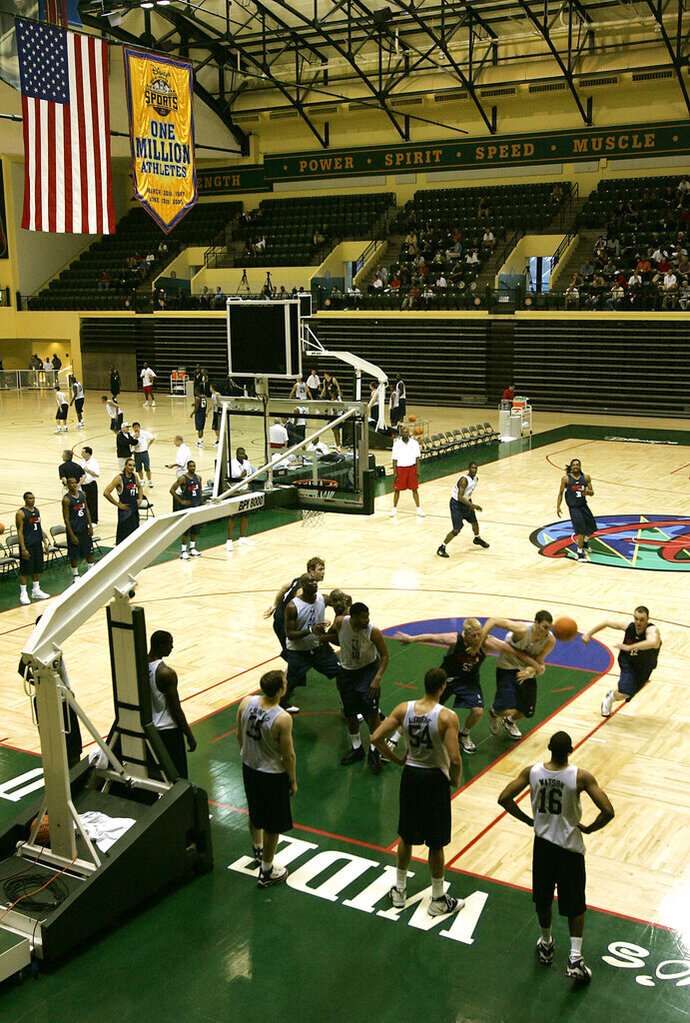 FILE - In this June 6, 2006, file photo, college players scrimmage during an NBA pre-draft basketball camp at the Disney Wide World of Sports complex in Kissimmee, Fla. Most of the 22 remaining NBA teams were taking the court for the first mandatory workouts in nearly four months Wednesday, July 1, 2020, as the league continued prepping for the restart of the season at the Disney campus near Orlando, Florida. Workouts are still individual in nature, but are no longer voluntary.  (AP Photo/John Raoux, File)