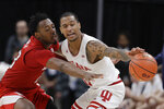 Indiana's Devonte Green (11) is fouled by Nebraska's Jervay Green (23) during the second half of an NCAA college basketball game at the Big Ten Conference tournament, Wednesday, March 11, 2020, in Indianapolis. Indiana won 89-64. (AP Photo/Darron Cummings)