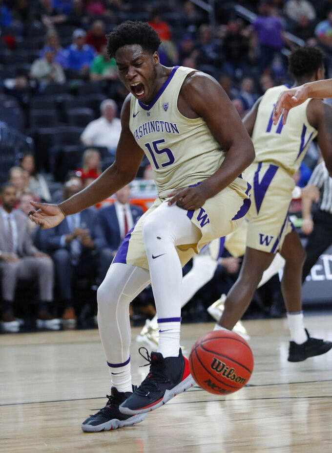 Washington's Noah Dickerson reacts after scoring against Southern California during the first half of an NCAA college basketball game in the quarterfinal round of the Pac-12 men's tournament Thursday, March 14, 2019, in Las Vegas. (AP Photo/John Locher)