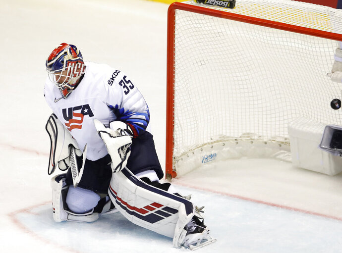 Goaltender Cory Schneider of the US fails to make a save during the Ice Hockey World Championships group A match between Canada and the United States at the Steel Arena in Kosice, Slovakia, Tuesday, May 21, 2019. (AP Photo/Petr David Josek)