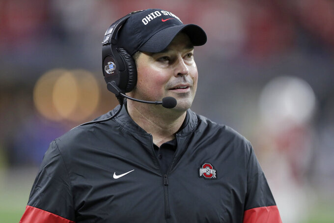 "FILE - In this Dec. 7, 2019, file photo, Ohio State head coach Ryan Day watches during the second half of the Big Ten championship NCAA college football game against Wisconsin, in Indianapolis. Between family time, trying to perfect a crock-pot chili recipe and binging on ""Tiger King"" on Netflix, Ohio State coach Ryan Day is spending his quarantined hours trying to keep coaches and players on track in the face of an uncertain future. (AP Photo/Michael Conroy, File)"