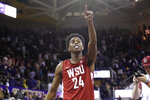 Washington State's Noah Williams points toward the stands after Washington State defeated Washington 78-74 in an NCAA college basketball game Friday, Feb. 28, 2020, in Seattle. (AP Photo/Elaine Thompson)