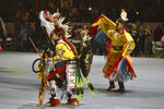 FILE - In this April 27, 2018, file photo, dancers enter at the Gathering of Nations, one of the world's largest gatherings of indigenous people in Albuquerque. Friday, April 26, 2019 marks the beginning of a two-day powwow in New Mexico that represents one of the largest annual gatherings of indigenous people in the United States. Organizers say they want to build awareness this year around the deaths and disappearances of Native American women. (AP Photo/ Russell Contreras, File)