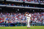 Philadelphia Phillies pitcher Aaron Nola tips his hat after being pulled in eighth inning of a baseball game against the New York Yankees, Sunday, June 13, 2021, in Philadelphia. (AP Photo/Matt Slocum)