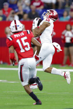 Indiana wide receiver Nick Westbrook, right, makes a catch in front of Ball State cornerback Tyler Potts (15) on his way to a touchdown during the first half of a college football game in Indianapolis, Saturday, Aug. 31, 2019. (AP Photo/Michael Conroy)