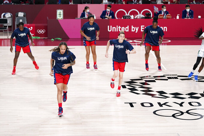 United State's Brittney Griner and Breanna Stewart warm up with teammates Tina Charles, rear left, A'ja Wilson and Sylvia Fowles, rear right, before a women's basketball preliminary round game against Nigeria at the 2020 Summer Olympics, Tuesday, July 27, 2021, in Saitama, Japan. The U.S. has an embarrassment of riches when it comes to talented post players, possibly the best ever assembled. (AP Photo/Charlie Neibergall)