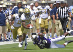 Georgia Tech defensive back Juanyeh Thomas (28) eludes a tackle by Alcorn State tight end Jerimiah Green (84)  in the first half of an NCAA college football game against Alcorn State  Saturday, Sept. 1, 2018, in Atlanta. (Hyosub Shin/Atlanta Journal-Constitution via AP)