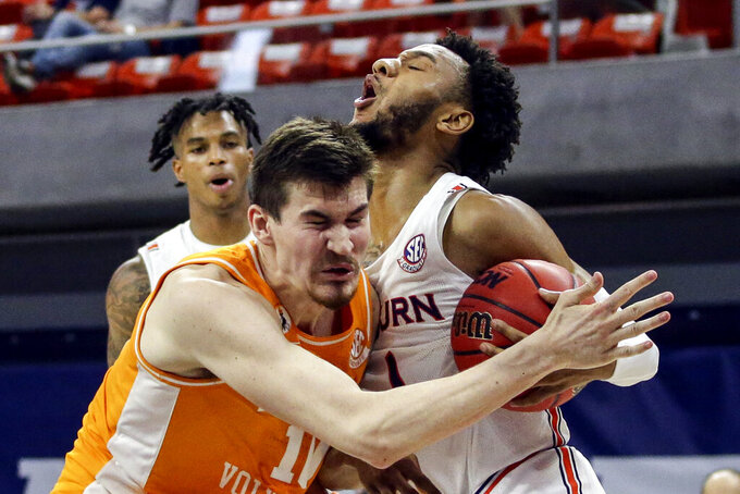 Tennessee forward John Fulkerson (10) and Auburn guard Jamal Johnson (1) collide while rebounding the ball during the second half of an NCAA basketball game Saturday, Feb. 27, 2021, in Auburn, Ala. Auburn won 77-72. (AP Photo/Butch Dill)