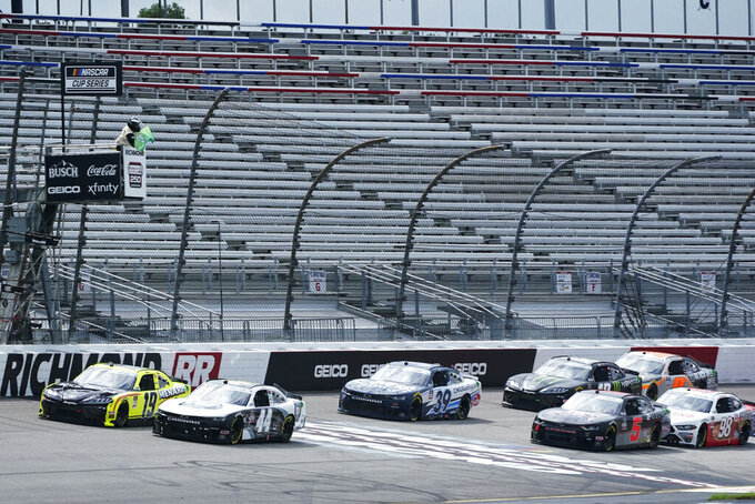 Brandon Jones (19) and Joe Martins (44) lead the field during start of a NASCAR Xfinity Series auto race Saturday, Sept. 1, 2020, in Richmond, Va. (AP Photo/Steve Helber)
