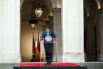 Italian Premier Giuseppe Conte prepares to announce new rules to curb the spread of COVID-19, in Rome, Sunday, Oct. 25, 2020. For at least the next month, people outdoors except for small children must now wear masks in all of Italy, gyms, cinemas and movie theaters will be closed, ski slopes are off-limits to all but competitive skiers and cafes and restaurants must shut down in early evenings, under a decree signed on Sunday by Conte, who ruled against another severe lockdown despite a current surge in COVID-19 infections. (Roberto Monaldo/LaPresse via AP)