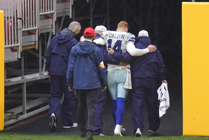 Dallas Cowboys quarterback Andy Dalton (14) is helped off the field after getting hit by Washington Football Team inside linebacker Jon Bostic (53) in the second half of an NFL football game, Sunday, Oct. 25, 2020, in Landover, Md. (AP Photo/Patrick Semansky)