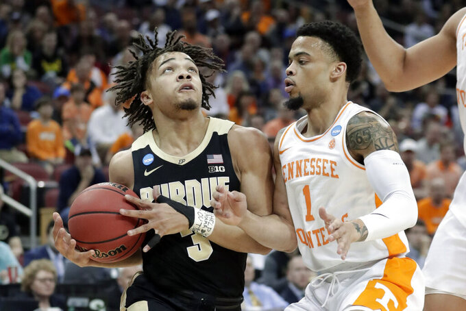 Purdue's Carsen Edwards (3) goes to the basket against Tennessee's Lamonte Turner (1) during the first half of a men's NCAA Tournament college basketball South Regional semifinal game, Thursday, March 28, 2019, in Louisville, Ky. (AP Photo/Michael Conroy)