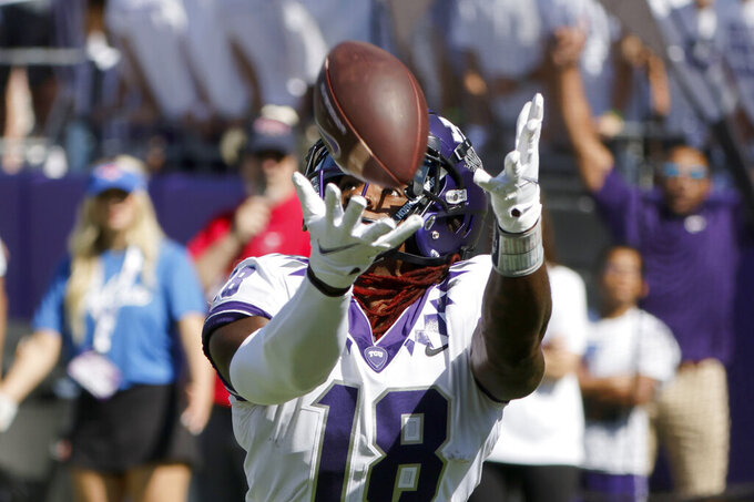 TCU wide receiver Savion Williams (18) fails to make a reception against SMU during the first half of an NCAA football game in Fort Worth, Texas, Saturday, Sept. 25, 2021. (AP Photo/Michael Ainsworth)