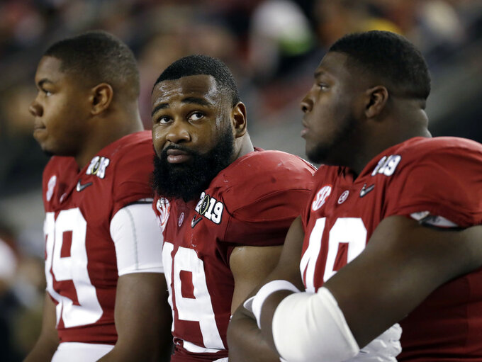Alabama's Isaiah Buggs reacts on the bench during the second half of the NCAA college football playoff championship game against Clemson, Monday, Jan. 7, 2019, in Santa Clara, Calif. (AP Photo/Chris Carlson)