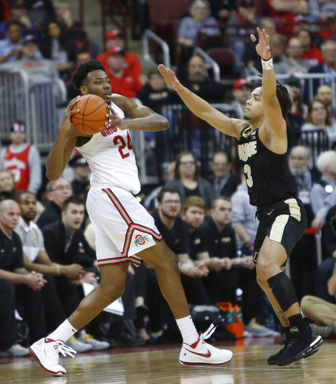 Ohio State's Andre Wesson, left, looks to pass the ball as Purdue's Carsen Edwards defends during the first half of an NCAA college basketball game Wednesday, Jan. 23, 2019, in Columbus, Ohio. (AP Photo/Jay LaPrete)