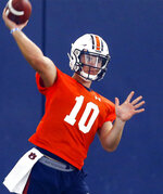 FILE - In this Aug. 2, 2019, file photo, Auburn quarterback Bo Nix throws a pass during NCAA college football practice in Auburn, Ala.  Freshman quarterback Bo Nix makes his college debut for No. 16 Auburn by matching up with No. 11 Oregon quarterback and potential first-round draft pick Justin Herbert in Arlington, Texas on Saturday, Aug. 31.  (AP Photo/Butch Dill, File)