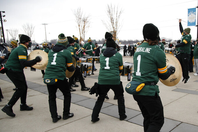 A drum line plays for fans outside of Lambeau Field before the NFC championship NFL football game between the Tampa Bay Buccaneers and Green Bay Packers in Green Bay, Wis., Sunday, Jan. 24, 2021. (AP Photo/Matt Ludtke)