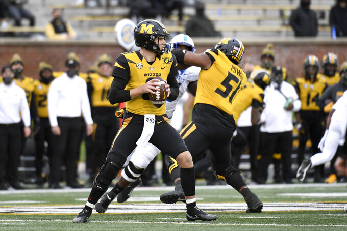 Missouri quarterback Connor Bazelak drops back to pass during the second half of an NCAA college football game against Kentucky Saturday, Oct. 24, 2020, in Columbia, Mo. (AP Photo/L.G. Patterson)