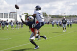 Tennessee Titans defensive back Dane Cruikshank (29) breaks up a pass intended for New England Patriots tight end Ben Watson (84) during a combined NFL football training camp Wednesday, Aug. 14, 2019, in Nashville, Tenn. (AP Photo/Mark Humphrey)