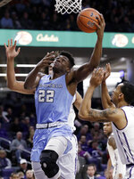 Columbia forward Ike Nweke (22) drives to the basket against Northwestern guard Ryan Taylor, right, and center Barret Benson during the first half of an NCAA college basketball game Sunday, Dec. 30, 2018, in Evanston, Ill. (AP Photo/Nam Y. Huh)