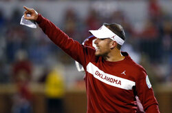 FILE - In this Saturday, Sept. 22, 2018, file photo, Oklahoma head coach Lincoln Riley gestures in the second of an NCAA college football game against Army in Norman, Okla. Oklahoma's hopes of making the college football playoff went washing down the Red River, after losing to Texas. (AP Photo/Sue Ogrocki, File)