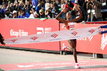 Brigid Kosgei of Kenya, wins the Women's Bank of America Chicago Marathon while setting a world record of 2:14:04, Sunday, Oct. 13, 2019, in Chicago. (AP Photo/Paul Beaty)