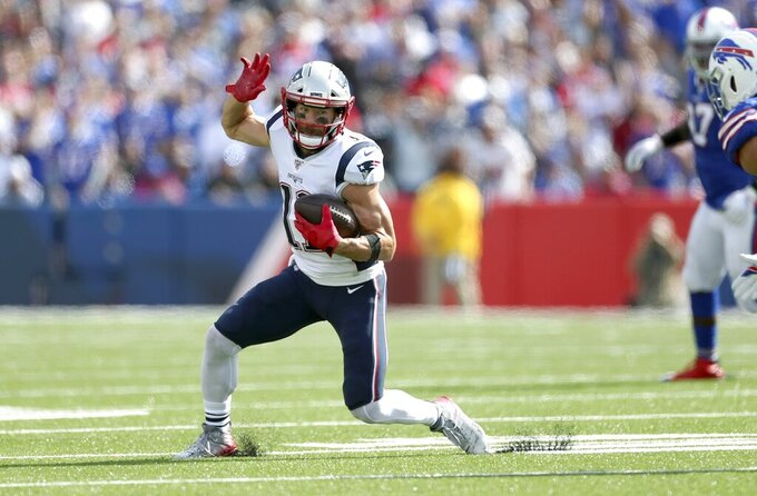 New England Patriots wide receiver Julian Edelman runs after catching a pass in the first half of an NFL football game against the Buffalo Bills, Sunday, Sept. 29, 2019, in Orchard Park, N.Y. (AP Photo/Ron Schwane)