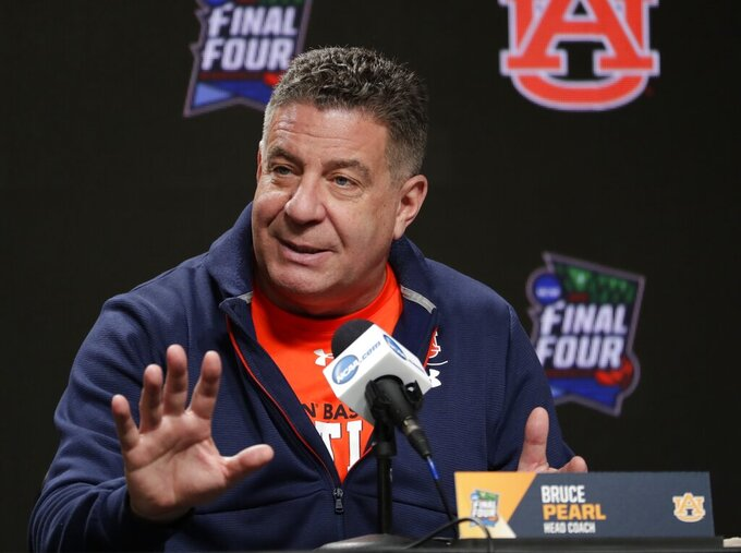 Auburn head coach Bruce Pearl answers questions after a practice session for the semifinals of the Final Four NCAA college basketball tournament, Thursday, April 4, 2019, in Minneapolis. (AP Photo/Matt York)