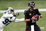 Carolina Panthers defensive end Yetur Gross-Matos (97) pressures Atlanta Falcons quarterback Matt Ryan (2) during the first half of an NFL football game, Sunday, Oct. 11, 2020, in Atlanta. (AP Photo/John Bazemore)