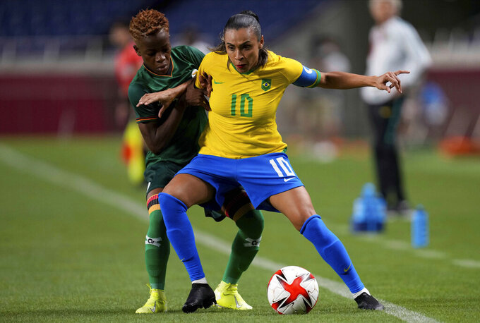 Zambia's Ireen Lungu, left, and Brazil's Marta battle for the ball during a women's soccer match at the 2020 Summer Olympics, Tuesday, July 27, 2021, in Saitama, Japan. (AP Photo/Martin Mejia)