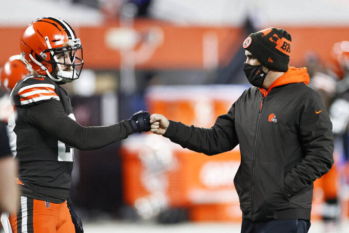 Cleveland Browns head coach Kevin Stefanski, right, fist-bumps strong safety Andrew Sendejo before an NFL football game against the Baltimore Ravens, Monday, Dec. 14, 2020, in Cleveland. The hard hitting between the Ravens and Browns in Monday night's thrilling game carried into Tuesday. Cleveland safety Andrew Sendejo sustained a concussion late in the fourth quarter after a collision at the goal line with Ravens rookie running back J.K. Dobbins, who gloated about the violent play on social media.(AP Photo/Ron Schwane)