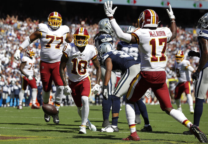 Washington Redskins wide receiver Paul Richardson (10) celebrate his touchdown with teammates offensive tackle Ereck Flowers (77) and wide receiver Terry McLaurin (17) in the second half of an NFL football game against the Dallas Cowboys, Sunday, Sept. 15, 2019, in Landover, Md. (AP Photo/Evan Vucci)