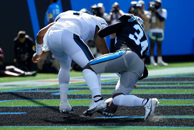Philadelphia Eagles quarterback Jalen Hurts chases a fumble into the end zone as Carolina Panthers defensive back Sean Chandler recovers for a safety during the first half of an NFL football game Sunday, Oct. 10, 2021, in Charlotte, N.C. (AP Photo/Jacob Kupferman)