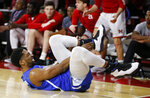 Buffalo guard CJ Massinburg grimaces as he holds his foot during the first half of an NCAA college basketball game against Miami (Ohio), Friday, March 1, 2019, in Oxford, Ohio. (AP Photo/Gary Landers)