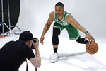 Boston Celtics' Grant Williams dribbles a ball for a photographer during the NBA basketball team's media day, Monday, Sept. 30, 2019 in Canton, Mass. (AP Photo/Elise Amendola)
