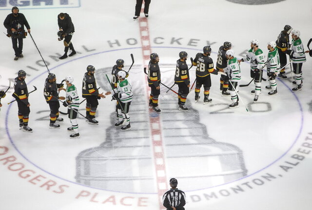 Dallas Stars and Vegas Golden Knights players shake hands after Dallas won in overtime NHL Western Conference final playoff game action in Edmonton, Alberta, Monday, Sept. 14, 2020. (Jason Franson/The Canadian Press via AP)