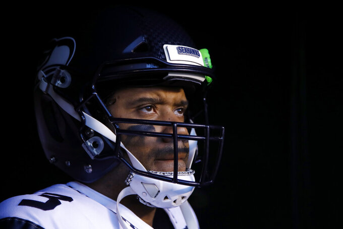 "FILE - In this Jan. 5, 2020, file photo, Seattle Seahawks' Russell Wilson waits to run onto the field for the team's NFL wild-card playoff football game against the Philadelphia Eagles in Philadelphia. Speaking to the media for the first time since the end of last season, Wilson didn't care to talk about the game that's helped make him famous. ""To be honest with you, I don't even want to talk about football right now,"" Wilson said during a video conference Wednesday, June 3. ""I can't compare football to life and what the black community is going through right now,"" he said. (AP Photo/Matt Rourke, File)"
