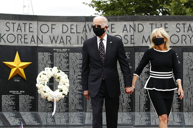 Democratic presidential candidate, former Vice President Joe Biden and Jill Biden depart after placing a wreath at the Delaware Memorial Bridge Veterans Memorial Park, Monday, May 25, 2020, in New Castle, Del. (AP Photo/Patrick Semansky)