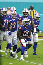 Buffalo Bills tight end Reggie Gilliam (86) celebrates with his teammates after scoring a touchdown, during the first half of an NFL football game against the Miami Dolphins, Sunday, Sept. 20, 2020, in Miami Gardens, Fla. (AP Photo/Lynne Sladky)