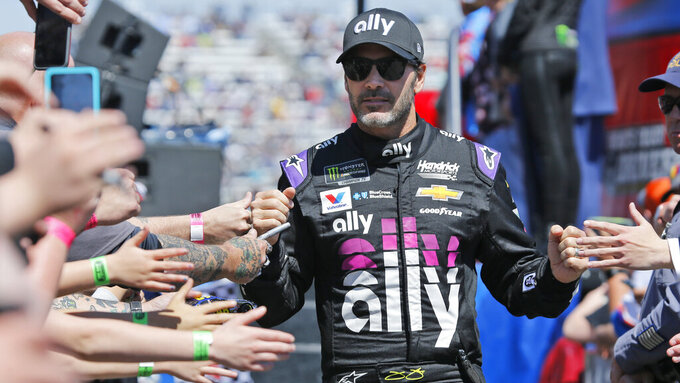 NASCAR Cup Series driver Jimmie Johnson (48) greets fans during driver introductions prior to the NASCAR Cup Series auto race at the Martinsville Speedway in Martinsville, Va., Sunday, March 24, 2019. (AP Photo/Steve Helber)