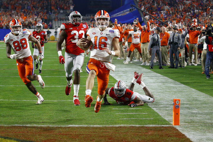 Clemson quarterback Trevor Lawrence runs in for a touchdown against Ohio State during the first half of the Fiesta Bowl NCAA college football playoff semifinal Saturday, Dec. 28, 2019, in Glendale, Ariz. (AP Photo/Ross D. Franklin)