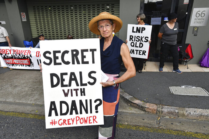 FILE - In this April 11, 2019, photo, anti-Adani coal mine protestor Rae Sheridan is seen outside the LNP (Liberal National Party) headquarters in Brisbane. The protestors are trying to stop the building of Adani's Carmichael coal mine. (Darren England/AAP Image via AP)