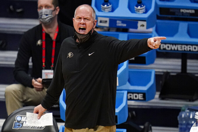 Colorado head coach Tad Boyle yells to his team as they plays against Georgetown in the first half of a first-round game in the NCAA men's college basketball tournament at Hinkle Fieldhouse in Indianapolis, Saturday, March 20, 2021. (AP Photo/Michael Conroy)