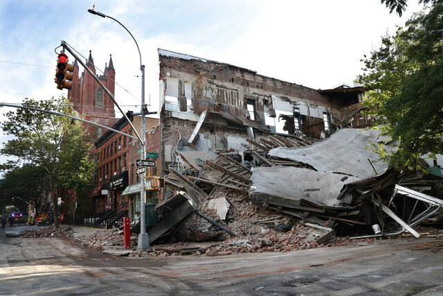 The remains of a multistory building that housed a health club is shown after it collapsed, Wednesday, July 1, 2020, in the Carroll Gardens neighborhood of the Brooklyn borough of New York. Building inspectors had ordered a halt to some construction work at the location because of structural problems just three weeks before the collapse. (AP Photo/Kathy Willens)